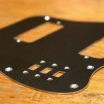 Anodised black metal pickguard